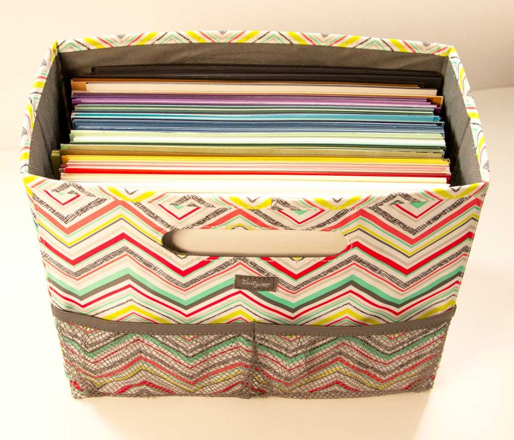 Bright zig zag patterned fabric covering a paper file holder filled with colorful cardstock