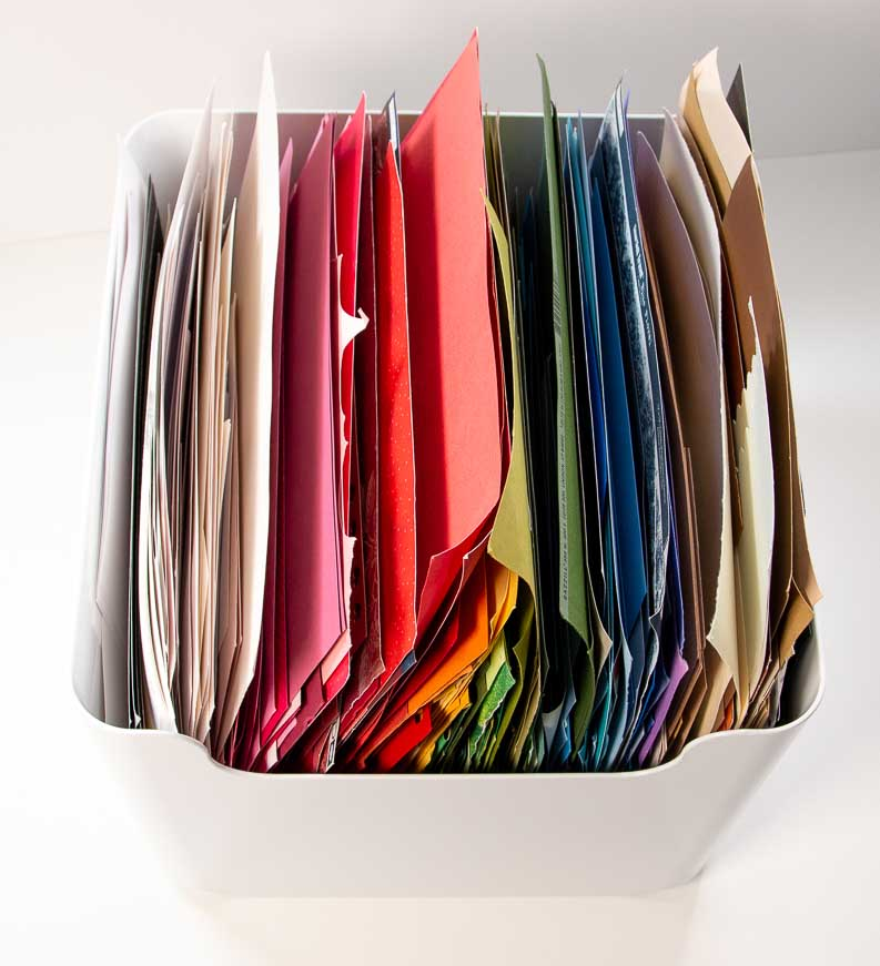 White plastic bin filled with colorful cardstock bins