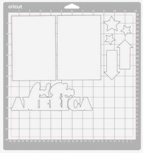 Ciricut Cutting mat with white items neatly lined up